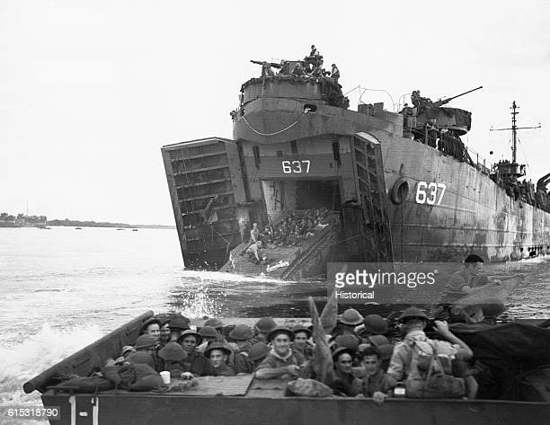 Australian troops on a landing craft during landing operations on Labuan Island, Borneo, Indonesia. A LVT troop carrier is coming out of a LST-637...