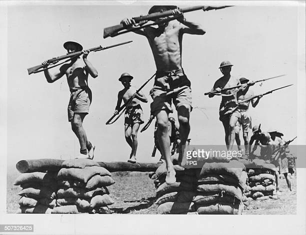 Australian troops on an obstacle course training during World War Two Australia circa 1943