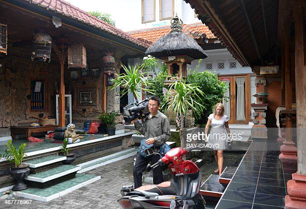 Australian TV crew members reports at the house where Australian drug trafficker Schapelle Corby's sister Mercedes Corby lives in Kuta on February 8...