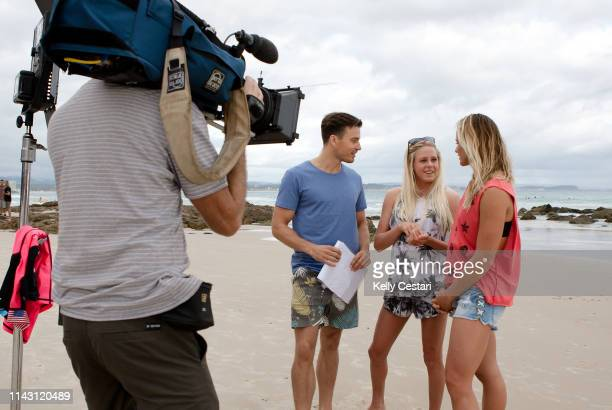 Australian TV presenter James Tobin was given a surfing lesson by Laura Enever of Hawaii and Courtney Conlogue of the USA on a layday at the 2014...