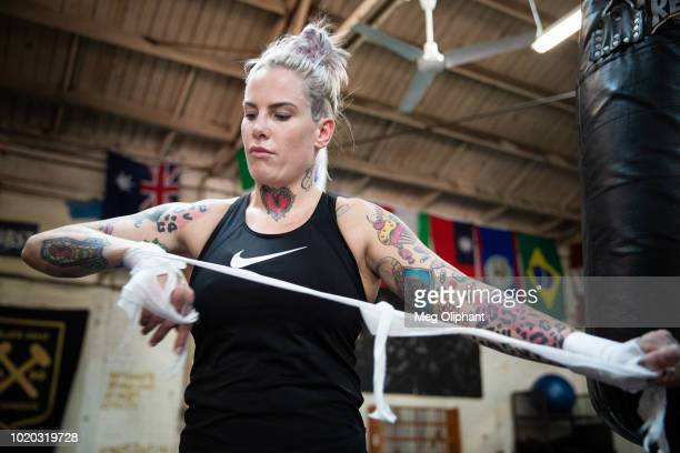 Australian UFC veteran and bare knuckle fighter Bec Rawlings undoes her tape at City of Angels Boxing Club on August 16 2018 in Los Angeles California