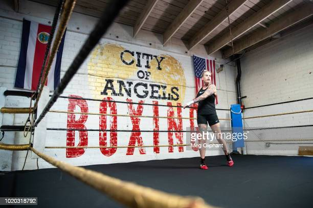 Australian UFC veteran and bare knuckle fighter Bec Rawlings warms up and demonstrates bare knuckle boxing moves at City of Angels Boxing Club on...