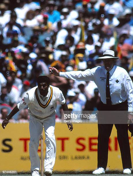 Australian umpire Darrell Hair no balls Muttiah Muralitharan of Sri Lanka during the second test match between Australia and Sri Lanka at the...