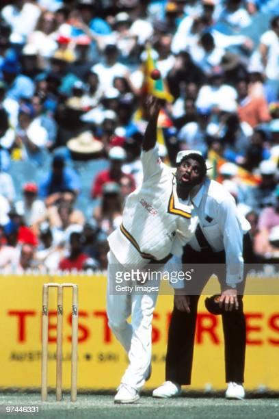 Australian umpire Darrell Hair watches Muttiah Muralitharan of Sri Lanka bowl during the second test match between Australia and Sri Lanka at the...