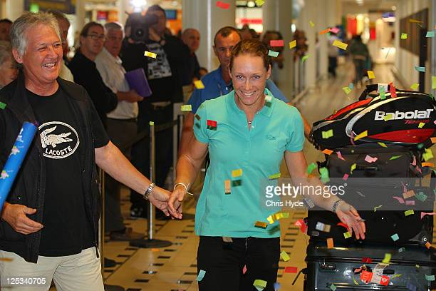 Australian US Open champion Sam Stosur is greeted by father Tony Stosur as she arrives home at Brisbane Airport on September 17 2011 in Brisbane...