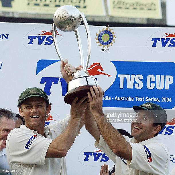 Australian vice captain Adam Gilchrist and skipper Ricky Ponting hold the TVS Cup after the presentation at the Wankhede Stadium Bombay 05 November...