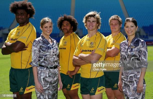 Australian Wallabies Berrick Barnes Tatafu PolotaNau Michael Hooper and Radike Samo pose with Qantas Cabin Crew Ally Brown and Ingrid Tyler with...