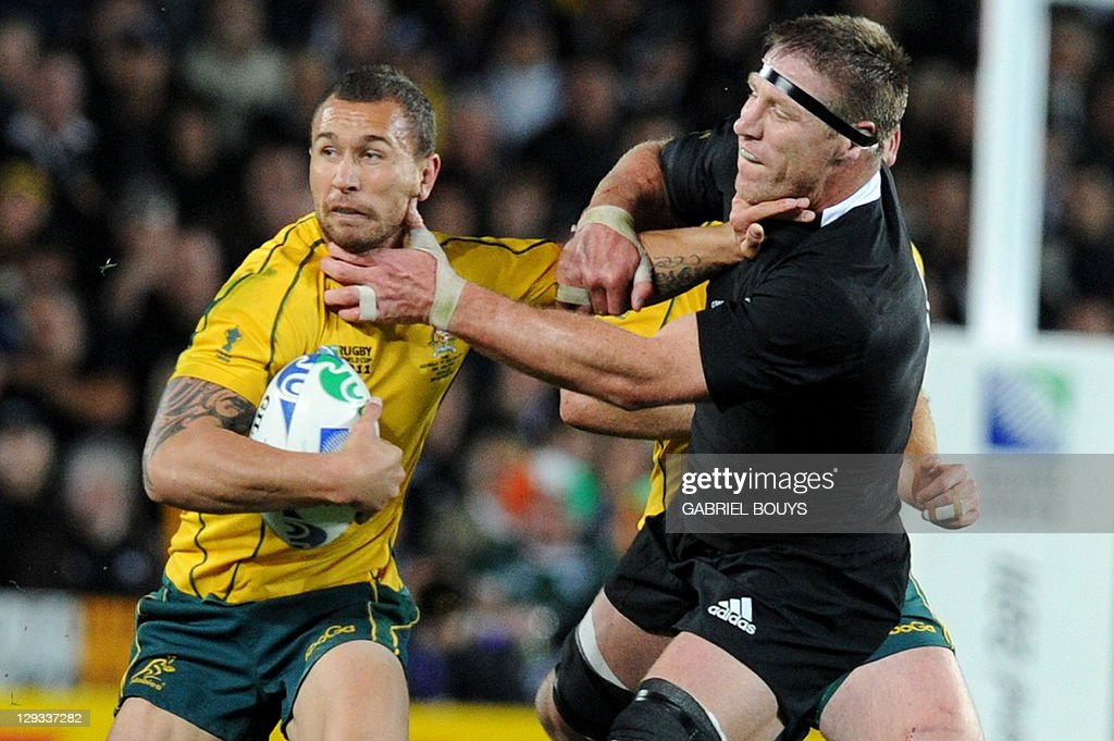 Australian Wallabies fly-half Quade Cooper (L) is tackled by New Zealand All Black lock Brad Thorn during the 2011 Rugby World Cup semi-final match Australia vs New Zealand at Eden Park Stadium in Auckland on October 16, 2011.
