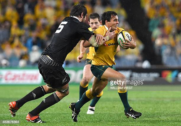 Australian Wallabies halfback Nick Phipps is tackled by New Zealand All Blacks lock Sam Whitelock during their rugby union Test Match in Sydney on...