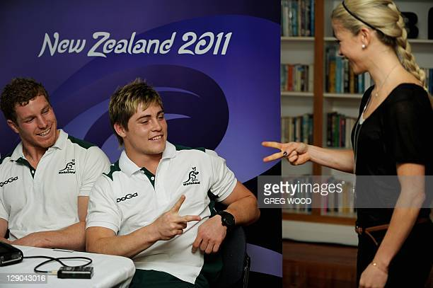 Australian Wallabies James O'Connor with teammate David Pocock plays a game of rock scissors paper with a member of the media at a press conference...