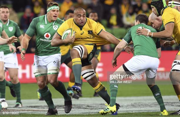 TOPSHOT Australian Wallabies player Caleb Timu attempts to break through the Ireland defence during the second rugby union Test match between Ireland...