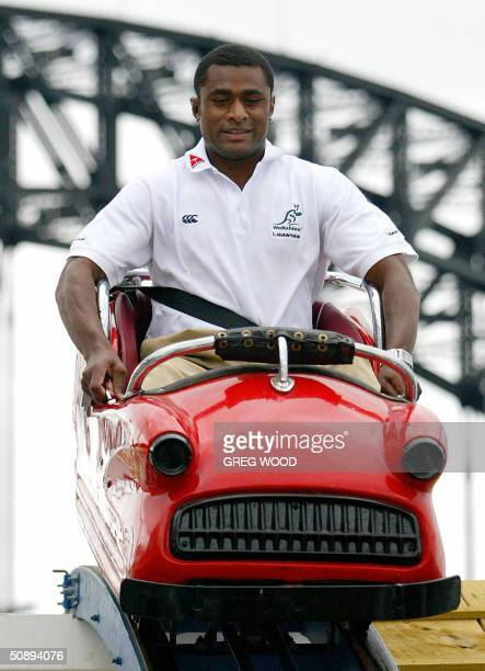 Australian Wallabies rugby union test newcomer Radike Samo enjoys a rollercoaster ride at Sydney's Luna Park, 25 May 2004. The Wallabies 27-man...