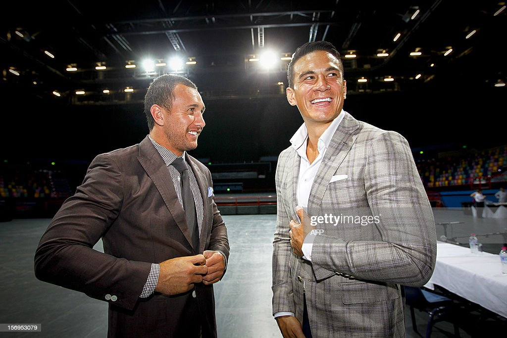 Australian Wallaby fly-half Quade Cooper (L) and former New Zealand All Black Sonny Bill Williams (R) attend a press conference in Brisbane on November 26, 2012. Cooper on November 26 said he was putting his rugby union career on hold as he prepares to make his debut in the boxing ring early next year. AFP PHOTO / Patrick HAMILTON