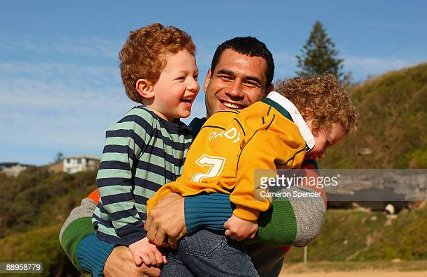 Australian Wallaby player George Smith laughs with his children at Warriewood beach on July 06 2009 in Sydney Australia Smith has played 99 test...