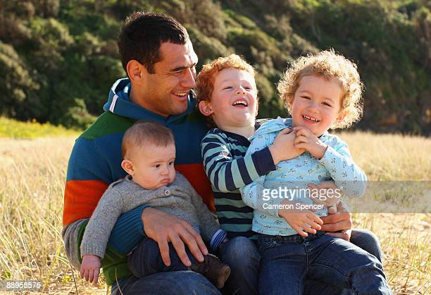 Australian Wallaby player George Smith poses with his sons Wyatt and Ryker and his daughter Soleil at Warriewood beach on July 06 2009 in Sydney...