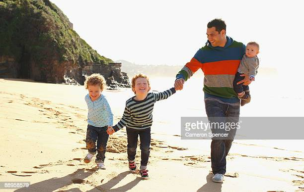 Australian Wallaby player George Smith walks with his children at Warriewood beach on July 06 2009 in Sydney Australia Smith has played 99 test...