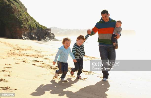 Australian Wallaby player George Smith walks with his sons Wyatt and Ryker and his daughter Soleil at Warriewood beach on July 06 2009 in Sydney...