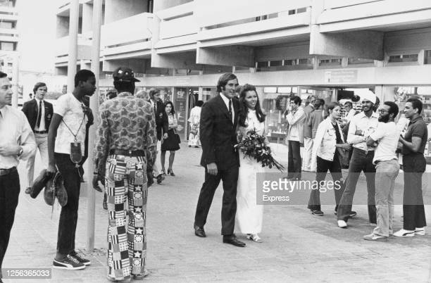 Australian water polo player David Woods and Judy Kerrison walk through the Olympic Village during the 1972 Summer Olympics, as they walk to their...