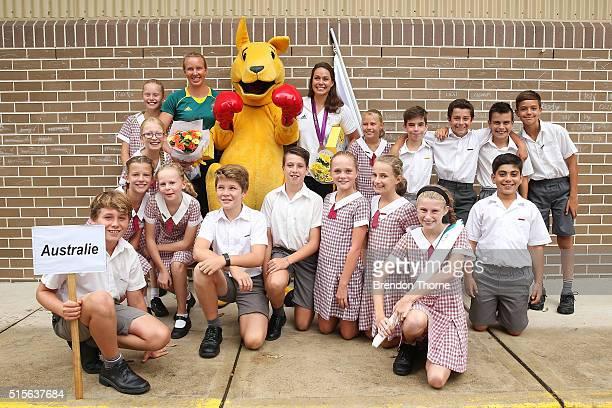 Australian Water Polo player, Nicola Zagame and Australian Canoe & Kayaker, Jo Bridgen-Jones interacts pose with students during the Australian...
