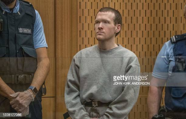 TOPSHOT Australian white supremacist Brenton Tarrant attends his first day in court in Christchurch on August 24 2020 Tarrant who murdered 51 Muslims...