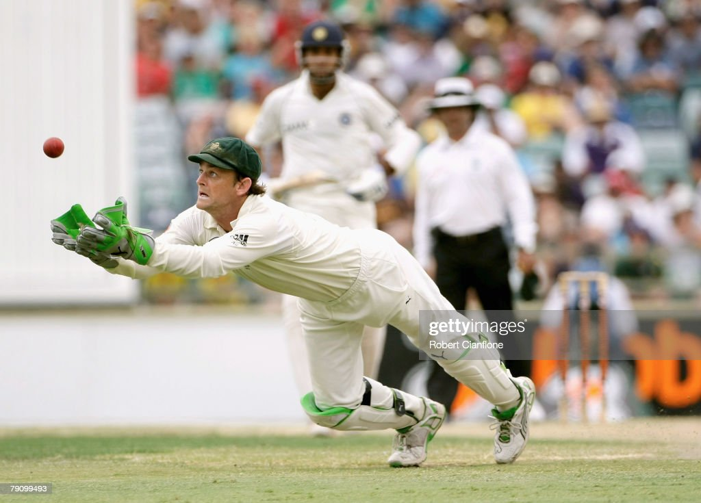 Australian wicket keeper Adam Gilchrist makes a diving catch to dismiss Mahendra Dhoni of India off the bowling of Andrew Symonds during day three of the Third Test match between Australia and India at the WACA on January 18, 2008 in Perth, Australia.