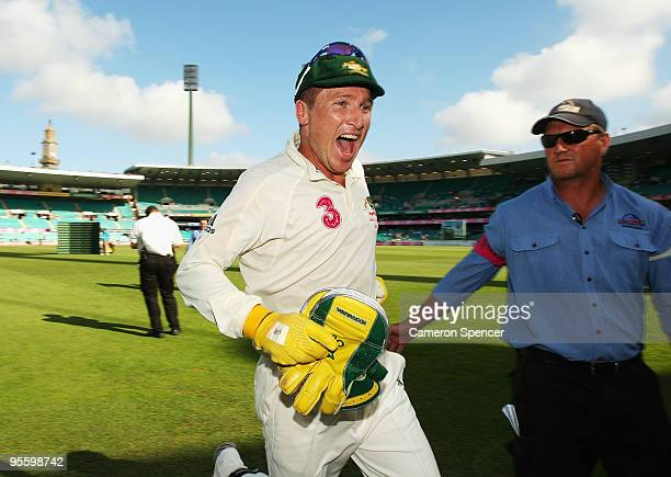 Australian wicket keeper Brad Haddin shows his emotion as he runs off the field after winning the test during day four of the Second Test between...