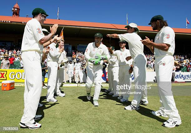 Australian wicketkeeper Adam Gilchrist is given a guard of honour by teammates as he makes his way onto the ground in his last test match appearance...