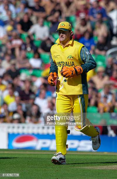 Australian wicketkeeper Adam Gilchrist running between ends at the end of an over during the ICC Champions Trophy match between Australia and New...