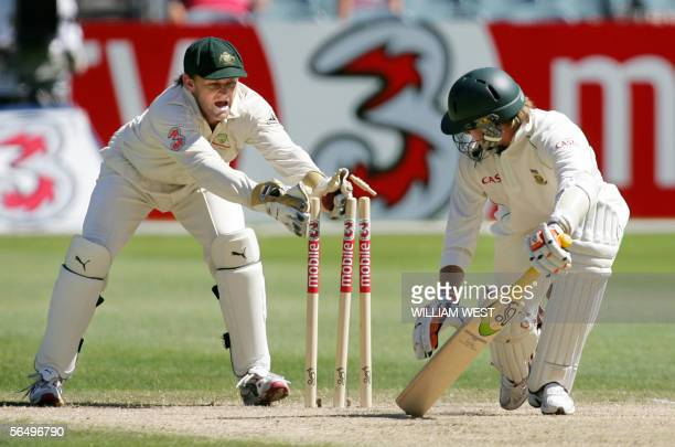 Australian wicketkeeper Adam Gilchrist stumps South African batsman AB de Villiers on the fourth day of the second Test Match being played at the MCG...