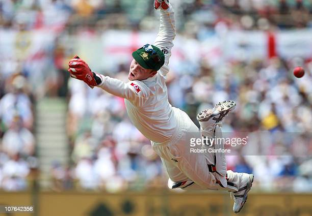 Australian wicketkeeper Brad Haddin dives for a wide ball during day two of the Third Ashes Test match between Australia and England at WACA on...