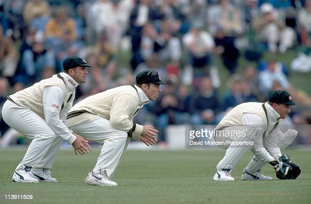 Australian wicketkeeper Ian Healy and slip fielders Michael Slater and Mark Taylor waiting for a chance during the match between the Duke of...