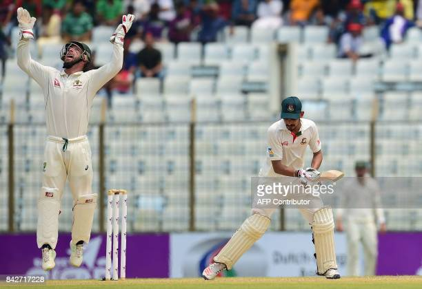 Australian wicketkeeper Matthew Wade reacts after the dismissal of the Bangladeshi cricketer Nasir Hossain during the second day of the second...