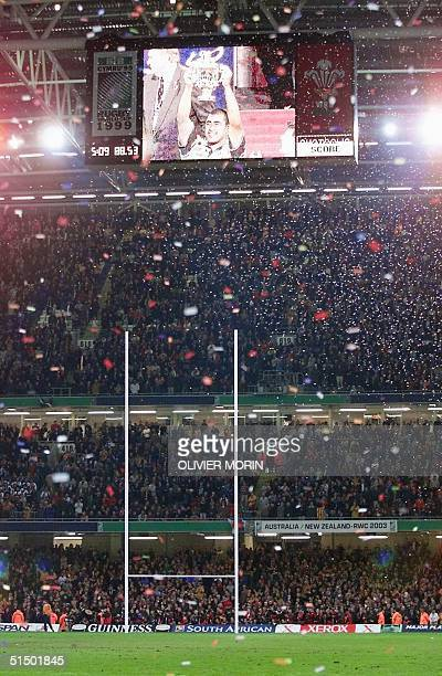 Australian winger Ben Tune appears on the stadium screen holding the cup after the Rugby World Cup 1999 final game opposing France to Australia 06...