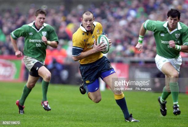 Australian winger Stirling Mortlock persued by Ireland's Shane Horgan and Ronan O'Gara during their International friendly match at Lansdowne Road in...