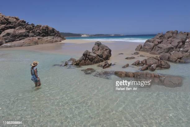 australian woman having fun in a rock pools in south western australia - rafael ben ari bildbanksfoton och bilder