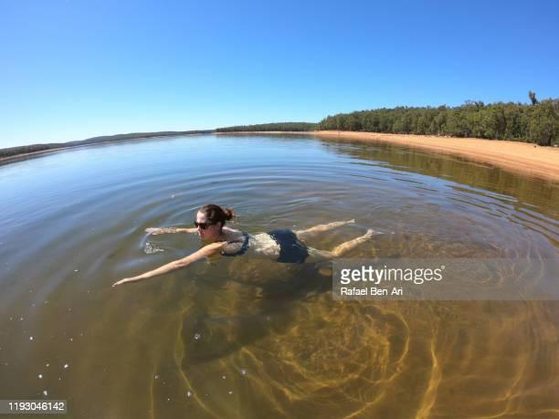 australian woman swimming in wellington reservoir in western australia - rafael ben ari bildbanksfoton och bilder