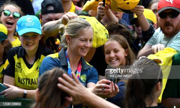 Australian women's Twenty20 cricket captain Meg Lanning poses for a photo with fans in Melbourne's Federation Square on March 9 a day after defeating...