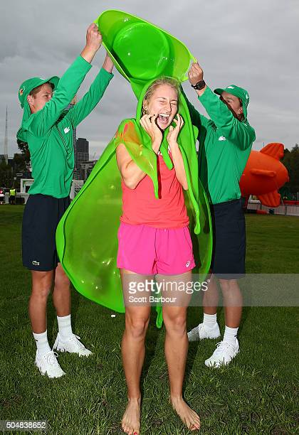 Australian world No36 ranked tennis player Daria Gavrilova is slimed by two ballkids as she tours the allnew Kids' World at the Australian Open...