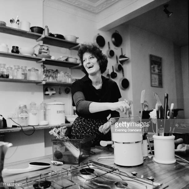 Australian writer and activist Germaine Greer in a kitchen UK 12th January 1976