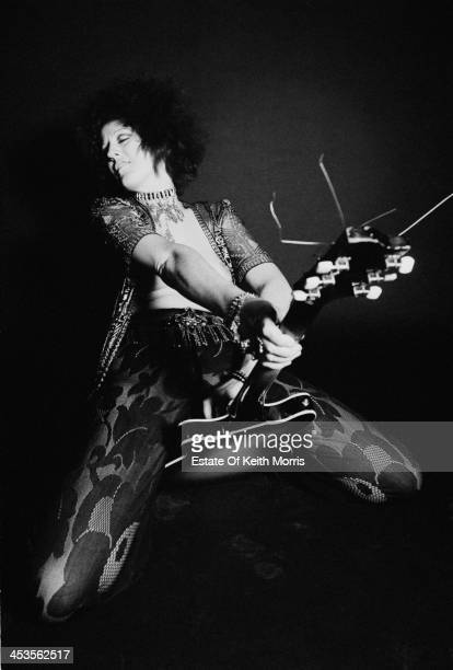 Australian writer and journalist Germaine Greer straddles an electric guitar in a photoshoot for the satirical underground magazine 'Oz' UK March 1969