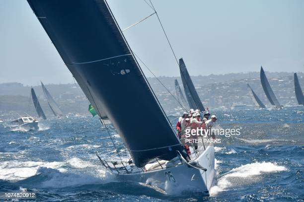 Australian yacht Gweilo sails out of Sydney Harbour at the start of the Sydney to Hobart yacht race on December 26 2018 Supermaxi Black Jack led a...