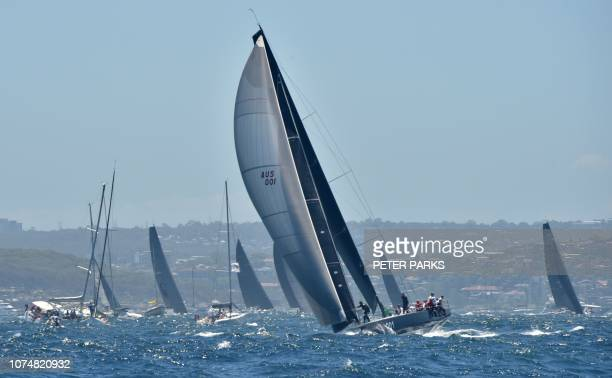 TOPSHOT Australian yacht Ichi Ban sails out of Sydney Harbour at the start of the Sydney to Hobart yacht race on December 26 2018 Supermaxi Black...