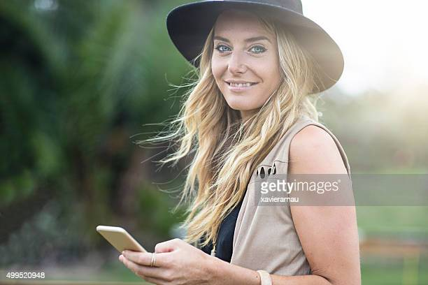 Australian young woman sending a message on the mobile phone