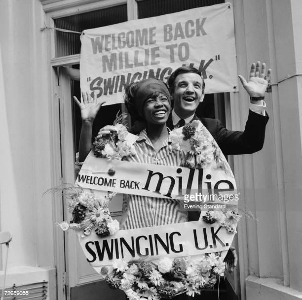 Australianborn British disc jockey Alan 'Fluff' Freeman welcomes Jamaican singer Millie Small back to the 'swinging UK' 1964