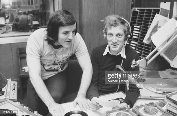 Australianborn British disc jockey Alan 'Fluff' Freeman with radio presenter Tom Browne at the BBC studios September 1972
