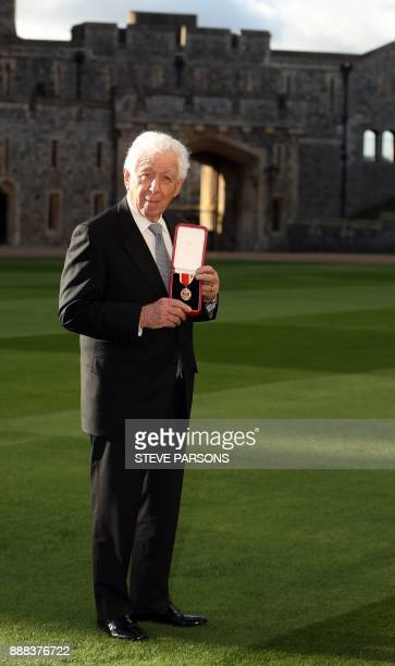 AustralianIsraeli businessman Frank Lowy chairman of the Westfield Corporation poses with his medal after being created a Knights Bachelor for...