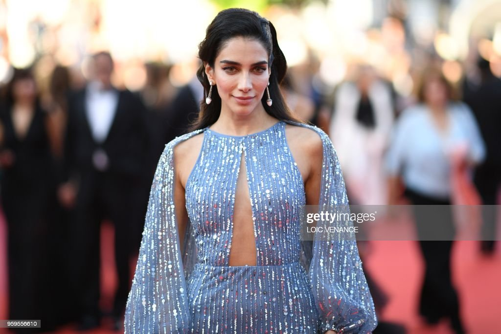 Australian-Lebanese tv host Jessica Kahawaty arrives on May 17, 2018 for the screening of the film 'Capharnaum' at the 71st edition of the Cannes Film Festival in Cannes, southern France.