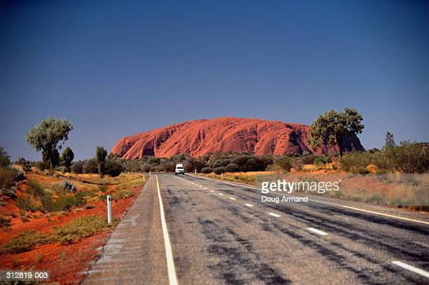 Australia,Northern Territories, road in fore of Ayers Rock,blue sky