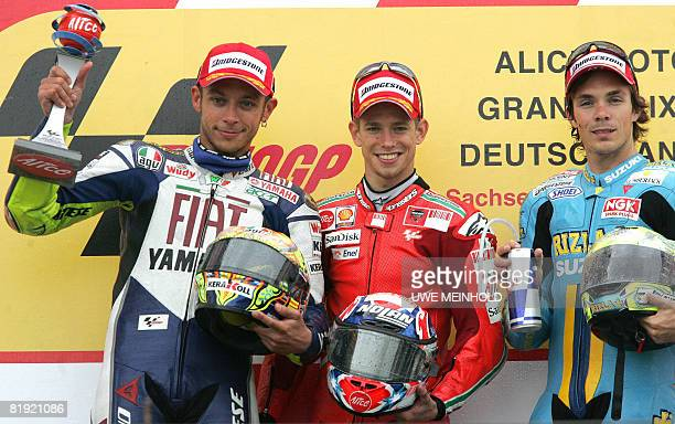 Australians Casey Stoner and Chris Vermeulen and Italy's Valentino Rossi celebrate on the podium after the 500cc race at the German Grand Prix...