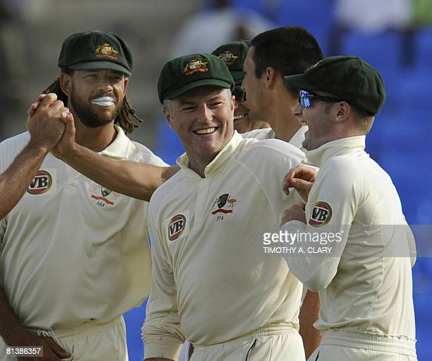 Australians Stuart MacGill Andrew Symonds and Michael Clarke celebrate after a West Indies out during the 2008 Digicel Home Series at the Sir Vivian...